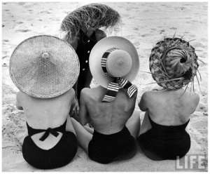 models-on-beach-wearing-different-designs-of-straw-hats